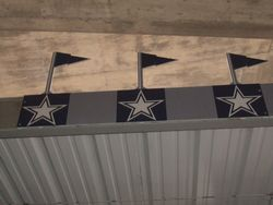 ABOVE THE CONCESSION STANDS WERE THESE LOGO S